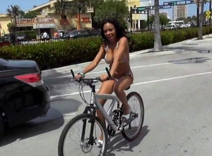 Youthful cyclist in marvelous bikini..