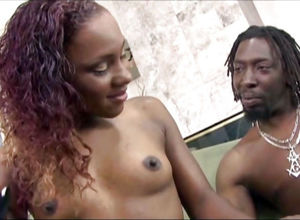 Mature dark-hued porno model Miss..
