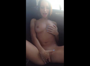 Chesty stunner unclothing in the car..