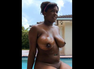 Huge-boobed dark-hued neighbor sitting..