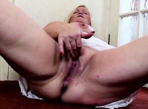 Blond Plus-size delights herself