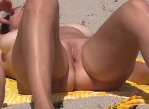 2 bare nymphs on beach