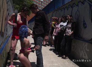 Blue haired sub deep-throats in public